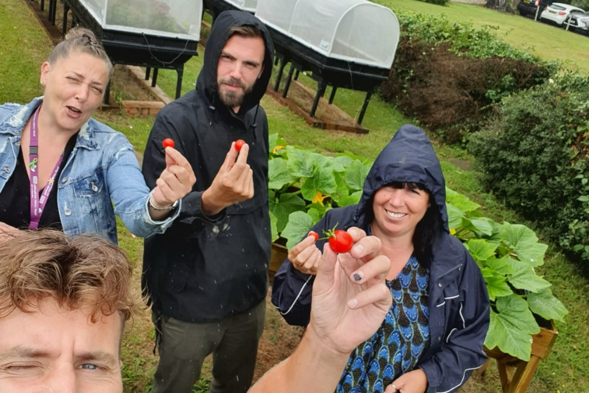 Gardeners show off the food they've grown as part of a project to help mental health and healthy guts